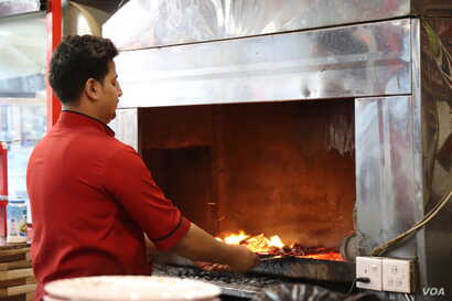 """""""They just went to the restaurant to get some food,"""" says Ali, a 24-year-old father who cooks kebabs for a living, describing a nearby attack on a local restaurant that killed three people. """"And now they are dead."""" Ali is pictured in Mosul, I..."""