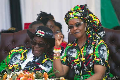 Zimbabwean first lady Grace Mugabe, right, is seen with her husband, President Robert Mugabe, at a rally in Gweru, Zimbabwe, Sept, 1, 2017.