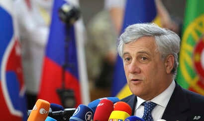 European Parliament President Antonio Tajani speaks with the media as he arrives for an EU summit at the Europa building in Brussels, June 22, 2017.