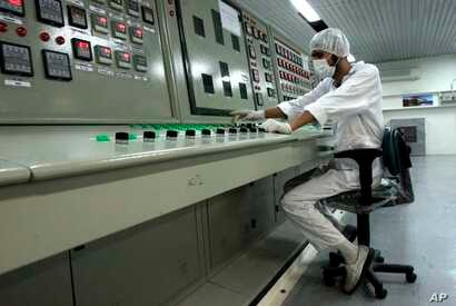 FILE - An Iranian technician works at the Uranium Conversion Facility just outside the city of Isfahan, Iran.