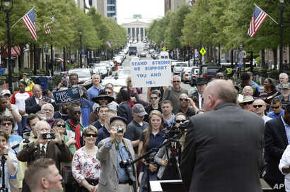 Supporters of House Bill 2 gather outside the North Carolina State Capitol in Raleigh, N.C., April 11, 2016.