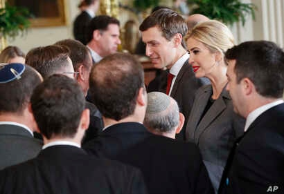 FILE - U.S. presidential adviser Jared Kushner, center, and his wife, Ivanka Trump, daughter of President Donald Trump, greet members of the Israeli delegation after a joint news conference between the president and Israeli Prime Minister Benjamin Ne...