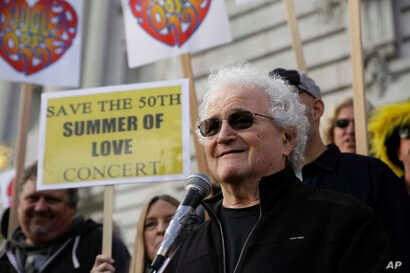 FILE - David Freiberg, who played with the Quicksilver Messenger Service and Jefferson Airplane bands, speaks in support of a Summer of Love anniversary concert during a rally outside City Hall in San Francisco, Feb. 16, 2017.