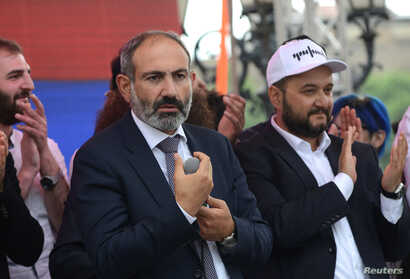 Newly elected Prime Minister of Armenia Nikol Pashinyan (C) meets with supporters in Republic Square in Yerevan, May 8, 2018.
