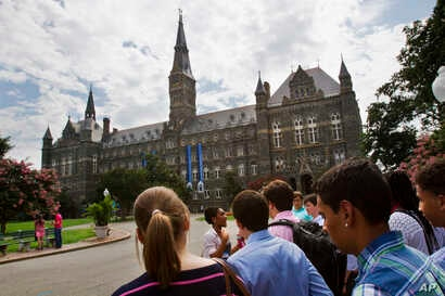 n this July 10, 2013, file photo, prospective students tour Georgetown University's campus in Washington.