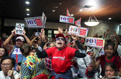Supporters of Pheu Thai Party react after unofficial results, during the general election in Bangkok, Thailand, March 24, 2019.