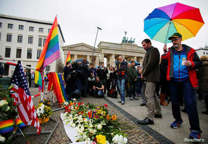 Vigil for victims of Pulse Orlando shooting in front of the U.S. Embassy and Brandenburg gate, Berlin, Germany, June 13, 2016.