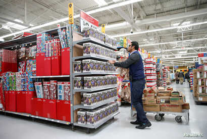 An employee works on a display ahead of Black Friday at a Walmart store in Chicago, Illinois, U.S., Nov. 20, 2018.