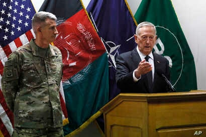 U.S. Defense Secretary James Mattis , right, and U.S. Army General John Nicholson, left, commander of U.S. Forces Afghanistan, hold a news conference at Resolute Support headquarters in Kabul, Afghanistan, April 24, 2017. Mattis arrived unannounced i...