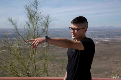 Ian Valdez, a 22-year-old El Paso resident and registered Republican, points to the direction of a nearby port of entry in the U.S. side. Valdez said though his parents immigrated to the U.S. from Mexico, he believes the immigration process of reques...