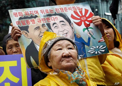 Former comfort woman Kil Un-ock who was forced to serve for the Japanese troops as a sexual slave during World War II, attends a rally against a visit by Japanese Prime Minster Shinzo Abe to the United States, in front of the Japanese Embassy in Seou