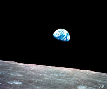 FILE - This Dec. 24, 1968, file photo made available by NASA shows the Earth behind the surface of the moon during the Apollo 8 mission.