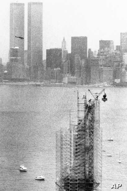 FILE - This July 4,1984, photo shows the original torch of the Statue of Liberty after it was removed from her grasp in New York. The torch, which was replaced by a replica, was moved into what will become its permanent home at a new museum on Libert...