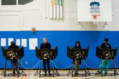Voters cast their ballots at the Tuttle Park Recreation Center polling location, Nov. 6, 2018, in Columbus, Ohio. Across the country, voters headed to the polls Tuesday in one of the most high-profile midterm elections in years.