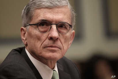 """FILE - FCC Chairman Tom Wheeler is shown giving testimony on Capitol Hill, March 17, 2015. Wheeler says the net neutrality ruling ensures the internet will remain """"a platform for unparalleled innovation, free expression and economic growth."""""""