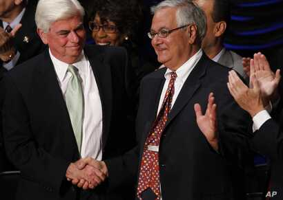 FILE - In this July 21, 2010, photo, Sen. Chris Dodd, D-Conn., left, and Rep. Barney Frank, D-Mass., shake hands at the signing ceremony for the Dodd-Frank Wall Street Reform and Consumer Protection financial overhaul bill  in Washington.