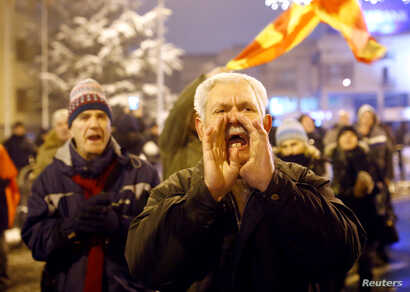 Supporters of the movement boycotting the deal with neighboring Greece to change the country's name to the Republic of North Macedonia protest in front of the parliament building during debates on the name change, in Skopje, Macedonia, Jan. 11, 2019....