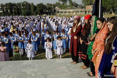 Students stand during morning assembly at the Islamabad College for girls in Islamabad, Pakistan, Oct. 13, 2017.