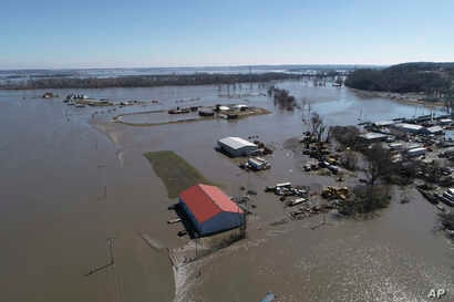 This March 20, 2019, aerial photo shows flooding near the Platte River in in Plattsmouth, Neb., south of Omaha. The National Weather Service is warning that flooding in parts of South Dakota and northern Iowa could soon reach historic levels.