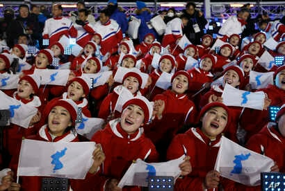 Members of the North Korean delegation hold flags of the combined Koreas before the opening ceremony of the 2018 Winter Olympics in Pyeongchang, South Korea, Feb. 9, 2018.