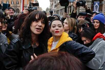 Actresses Asia Argento, left, and Rose McGowan pose during a demonstration to mark International Women's Day in Rome, March 8, 2018. Asia Argento, an Italian actress who helped launch the #MeToo movement, is launching a new movement, #WeToo, which ai...