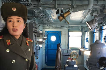 A North Korean military guide leads a tour of the USS Pueblo in Pyongyang, North Korea, Jan. 24, 2018. The Pueblo, an American spy ship, was attacked and captured by North Korea 50 years ago this week.