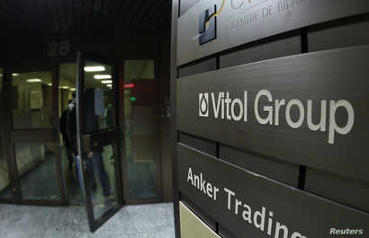 FILE - A sign is pictured in front of Vitol Group trading commodities company building in Geneva, Oct. 4, 2011.