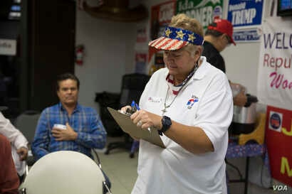 At the GOP headquarters in El Paso, Texas, a volunteer signs people in moments before U.S. Sen. Ted Cruz, R-Texas, narrowly defeated Democratic challenger Beto O'Rourke Tuesday, Nov. 6, 2018.
