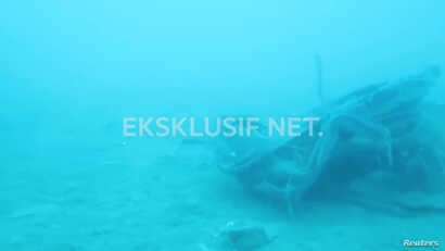 Debris, believed to be from Lion Air flight JT610 plane, which crashed, is seen during an operation by Navy divers near the search area off Tanjung Pakis, Indonesia, Oct. 31, 2018, in this still image taken from a video obtained from social media.