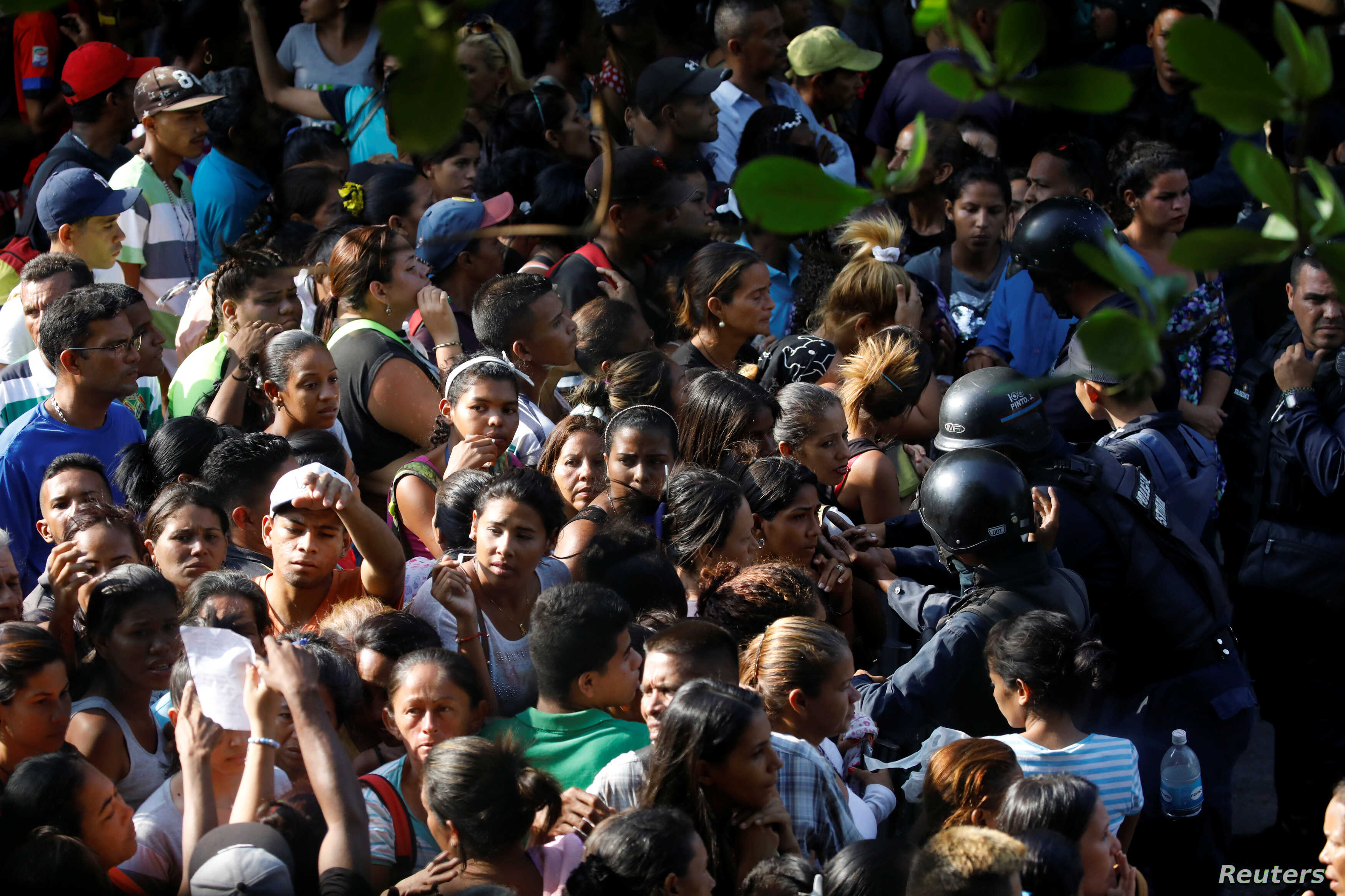 Relatives of inmates at the General Command of the Carabobo Police wait outside the prison in Valencia, Venezuela March 28, 2018.