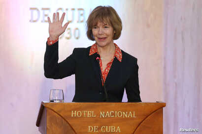 Minnesota Lt. Governor Tina Smith waves to journalists at the end of a news conference in a Hotel in Havana, Cuba, June 22, 2017.