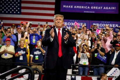FILE - President Donald Trump arrives to speak at a campaign rally at Florida State Fairgrounds Expo Hall, July 31, 2018, in Tampa, Fla.