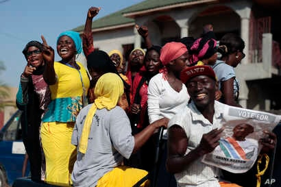 Gambians celebrate the victory of opposition coalition candidate Adama Barrow against longtime President Yahya Jammeh in the streets of Serrekunda, Gambia, Dec. 2, 2016.