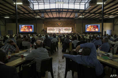 """Farmers, politicians and key role players in the agriculture sector listen to South Africa Deputy President David Mabuza speak as they attend AgriSA, a South African agricultural industry association, at a conference titled """"The Land Solution"""" on the..."""