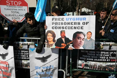 FILE - Uighurs and their supporters rally across the street from United Nations headquarters in New York, March 15, 2018.