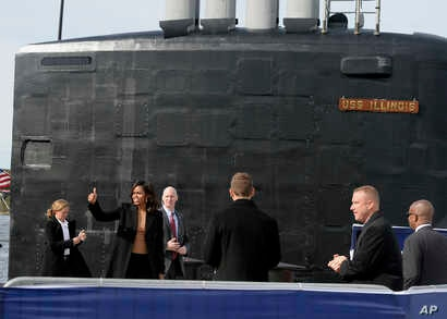 First lady Michelle Obama gives the thumbs up at the end of a commissioning ceremony for the U.S. Navy attack submarine USS Illinois, in Groton, Conn., Oct. 26, 2016. The submarine is named for Obama's home state of Illinois and the first lady is the...