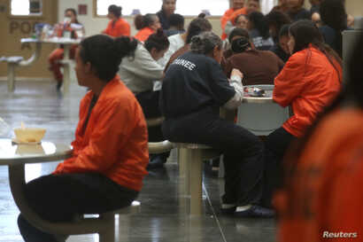 FILE - Detainees are seen at the Otay Mesa immigration detention center in San Diego, Calif., May 18, 2018.