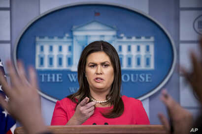 White House press secretary Sarah Huckabee Sanders calls on a member of the media during the daily press briefing at the White House, July 18, 2018, in Washington.
