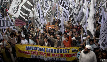 FILE - In this Feb. 26, 2011 file photo, supporters of Hafiz Saeed, the leader of a banned Islamic group Jamaat-ud-Dawa, an alias of the proscribed Lashkar -e-Taiba terror group, rally against India and United States in Lahore, Pakistan.