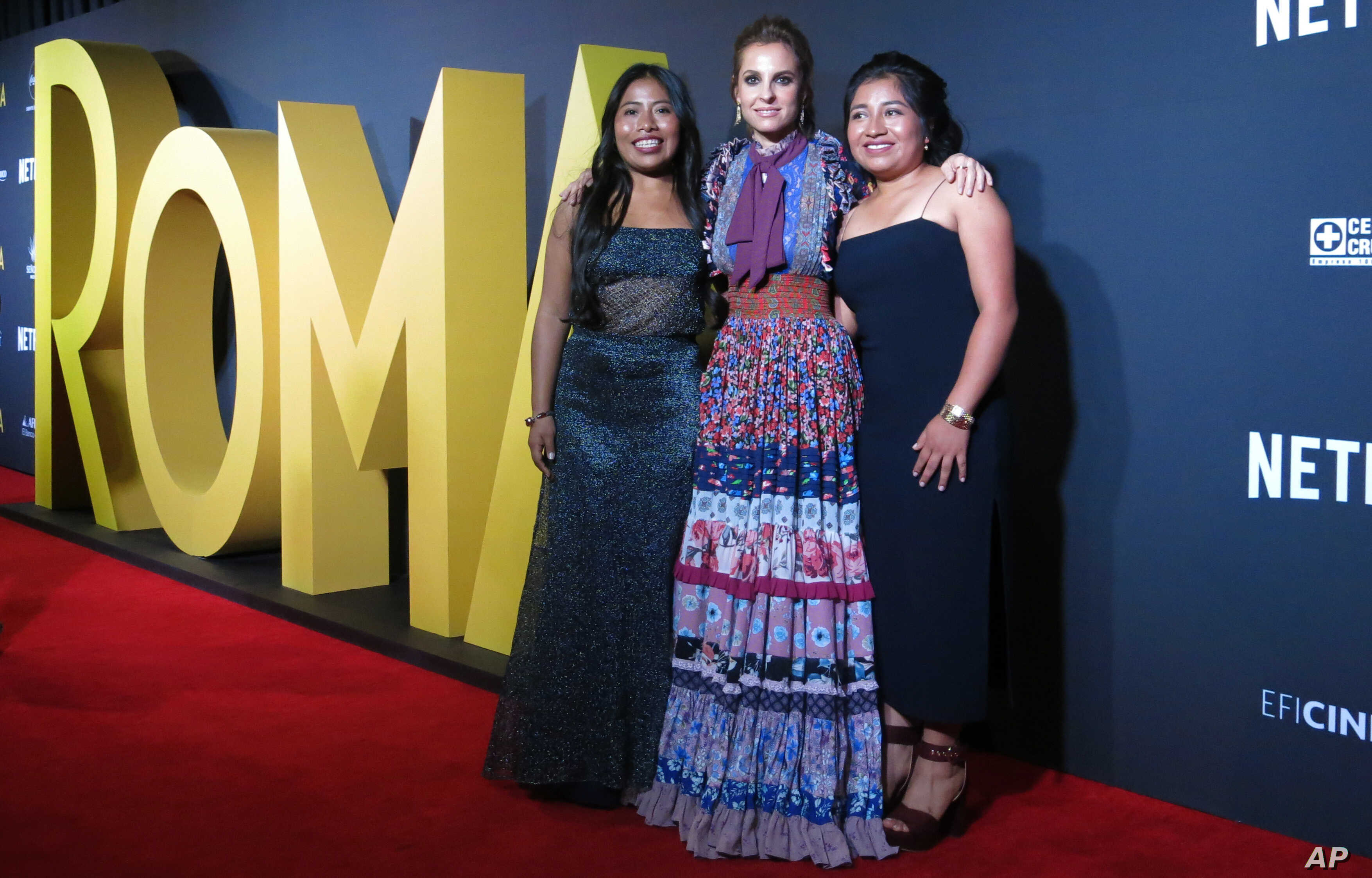 """FILE - Mexican actresses who star in the Mexican film """"Roma,"""" Yalitza Aparicio, from left, Marina de Tavira and Nancy Garcia, pose on the red carpet in Mexico City, Nov. 21, 2018."""