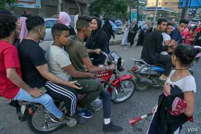 A young girl reacts to harassment from a group of young men on a motor bike during Eid Al-Fitr in Cairo, Egypt. in Giza, Egypt on Friday, June 15, 2018.