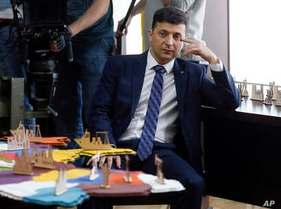 Ukrainian comedian Volodymyr Zelenskiy, who played the nation's president in a popular TV series, and is running for president in next month's election, is photographed on the set of a movie, in Kyev, Ukraine, Feb. 6, 2019.