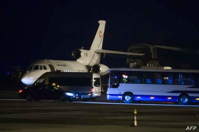 A Falcon 900 of the Swiss Air Force presumed to be carrying carrying American prisoners released by Iran is pictured on the tarmac of Geneva's airport, on Jan. 17, 2016.