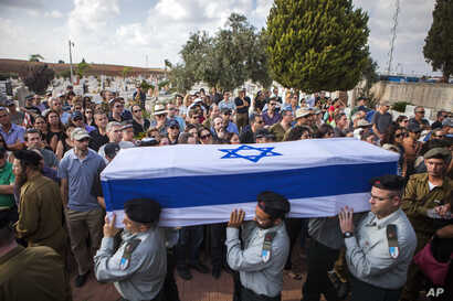 Israeli soldiers carry the coffin of Maj. Amotz Greenberg, 45, during his funeral in the Israeli city of Hod Hasharon, Sunday, July 20, 2014. According to reports, Greenberg was killed fighting a group of militants who infiltrated Israel through a tu...