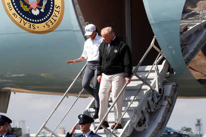 U.S. President Donald Trump steps off Air Force One as the president arrives to tour storm damage from Hurricane Michael at Eglin Air Force Base, Florida, Oct. 15, 2018.