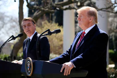 President Donald Trump and visiting Brazilian President Jair Bolsonaro speak during a news conference in the Rose Garden of the White House, March 19, 2019.