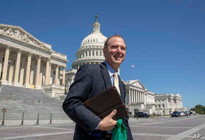 FILE - Rep. Adam Schiff, D-Calif., Chairman of the House Intelligence Committee, walks across the plaza on Capitol Hill in Washington.