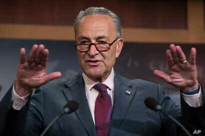 FILE - Senate Minority Leader Chuck Schumer of New York speaks to reporters on Capitol Hill in Washington, July 28, 2017, after the Republican-controlled Senate proved unable to repeal and replace the Affordable Care Act.