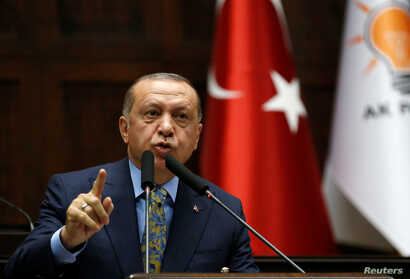 Turkish President Tayyip Erdogan addresses members of parliament from his ruling AK Party (AKP) during a meeting at the Turkish parliament in Ankara, Turkey, Oct. 23, 2018.