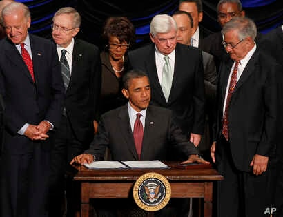FILE - President Barack Obama gets ready to sign the Dodd-Frank Wall Street Reform and Consumer Protection Act at the Ronald Reagan Building in Washington, July 21, 2010.